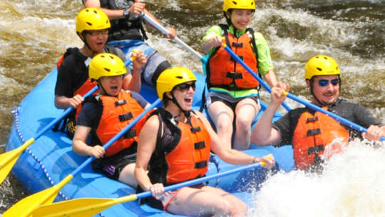 Group of women rafting