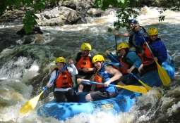 People rafting down a river