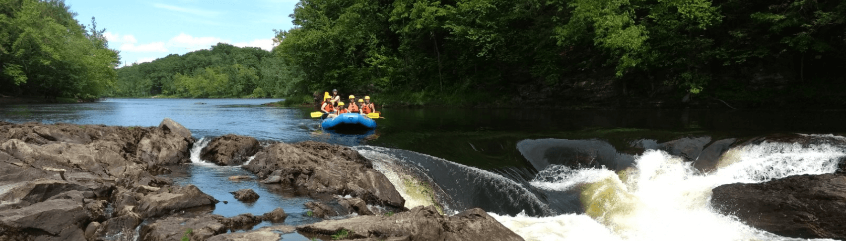 Raft group approaching a small rapid