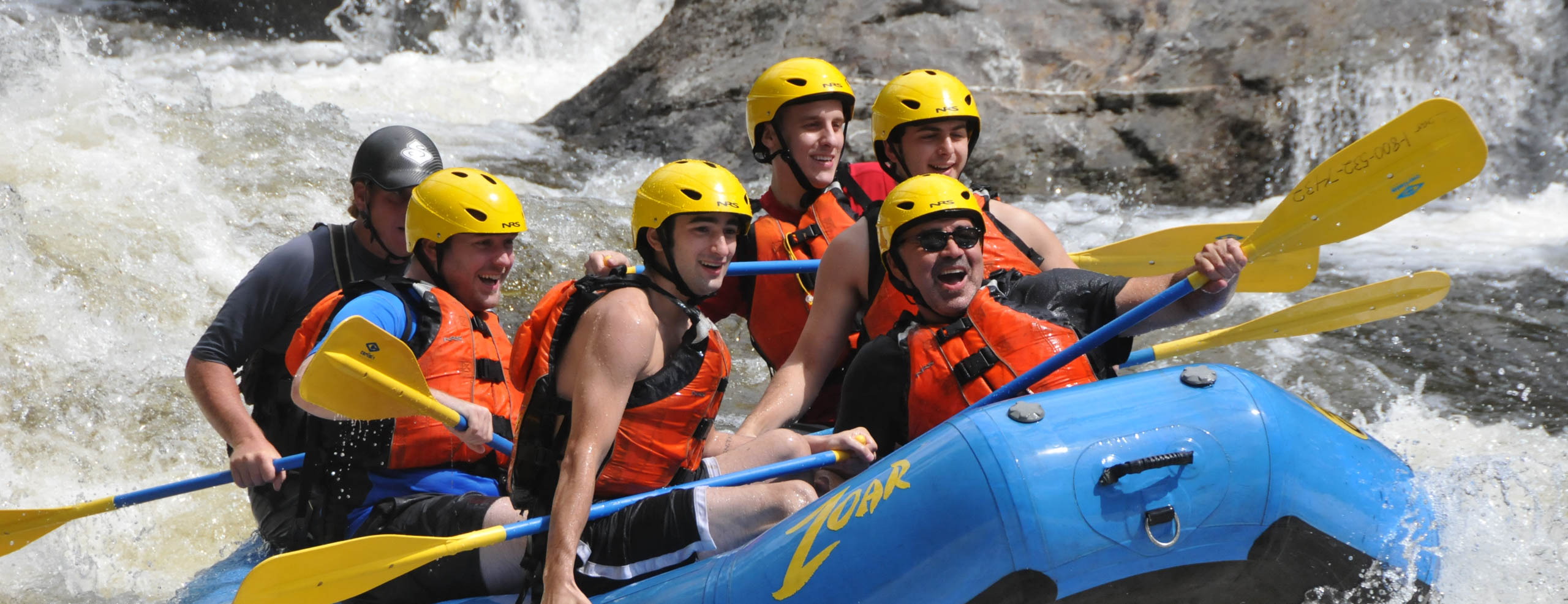 Group of people rafting down the Dryway river