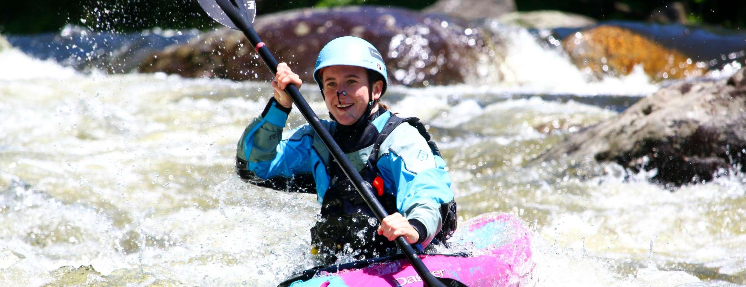 Woman kayaking rapids