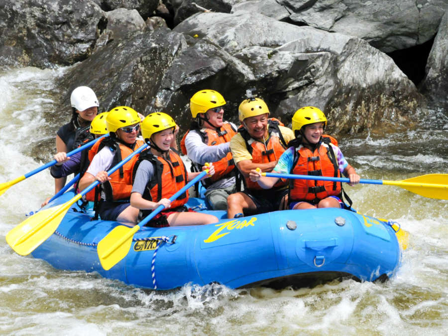 Group of people in a rafting boat