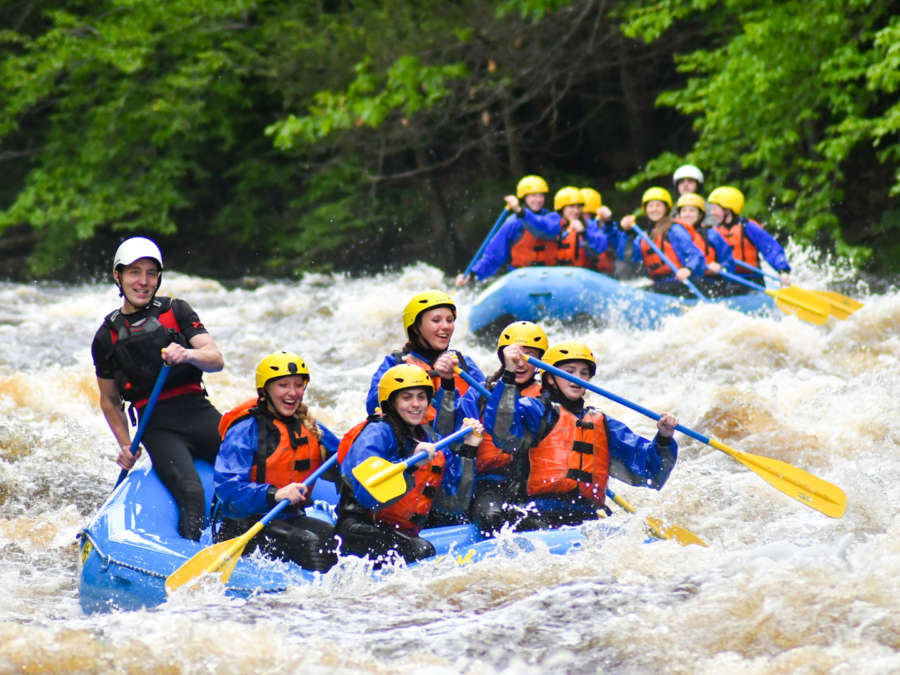 Group of rafters navigating rapids