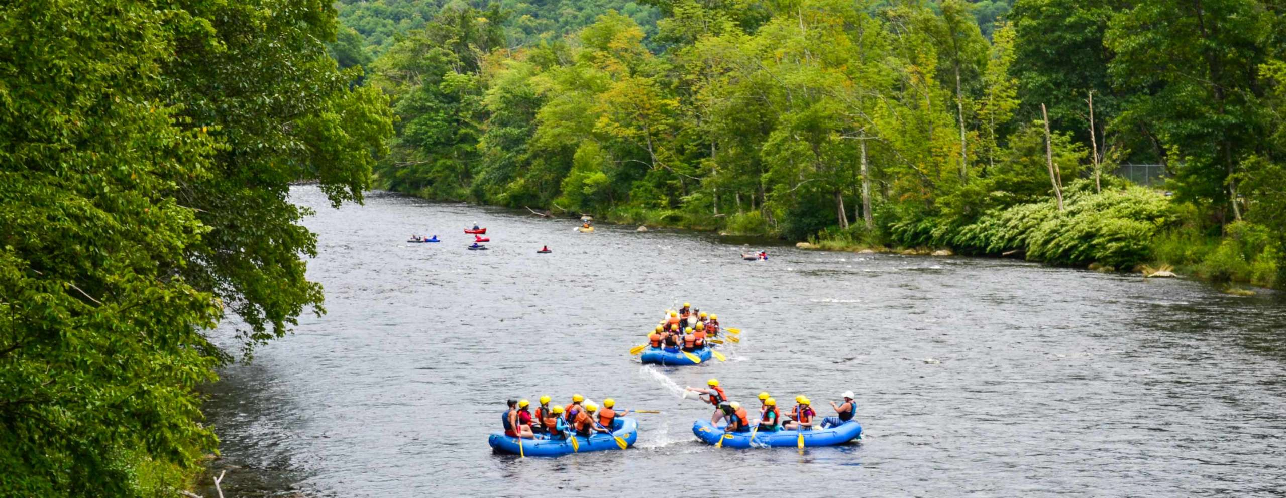 Zoar gap trip rafting down a tree lined river