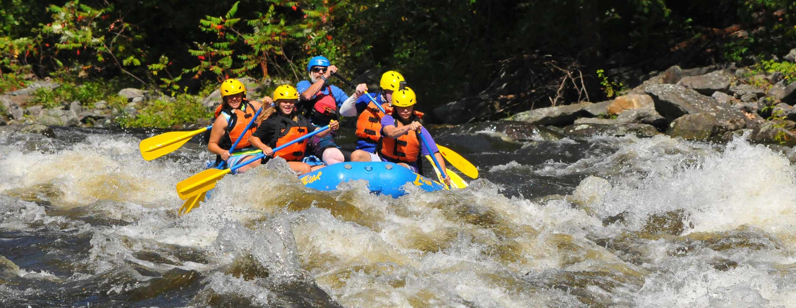 Group navigating the west river rapids
