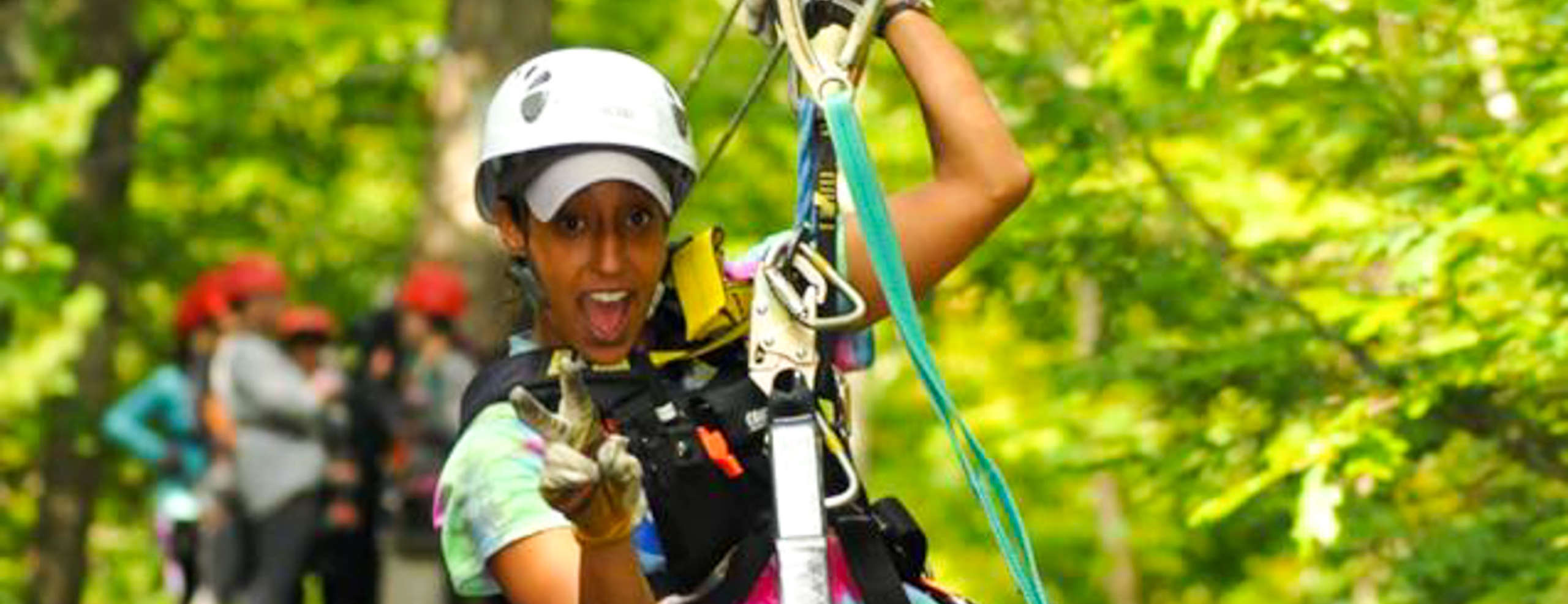Woman ziplining in the forest