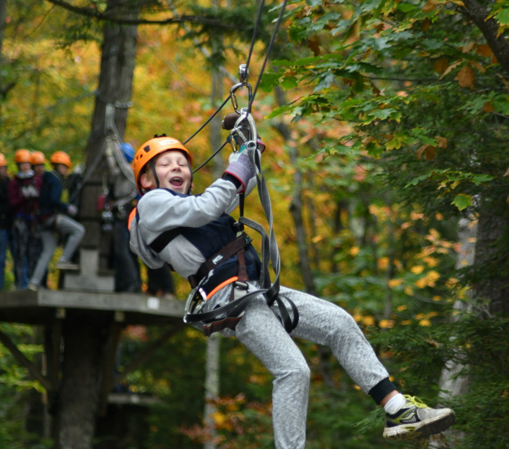Young Boy Zipping in fall