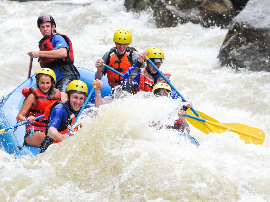 Group in a raft navigating strong rapids