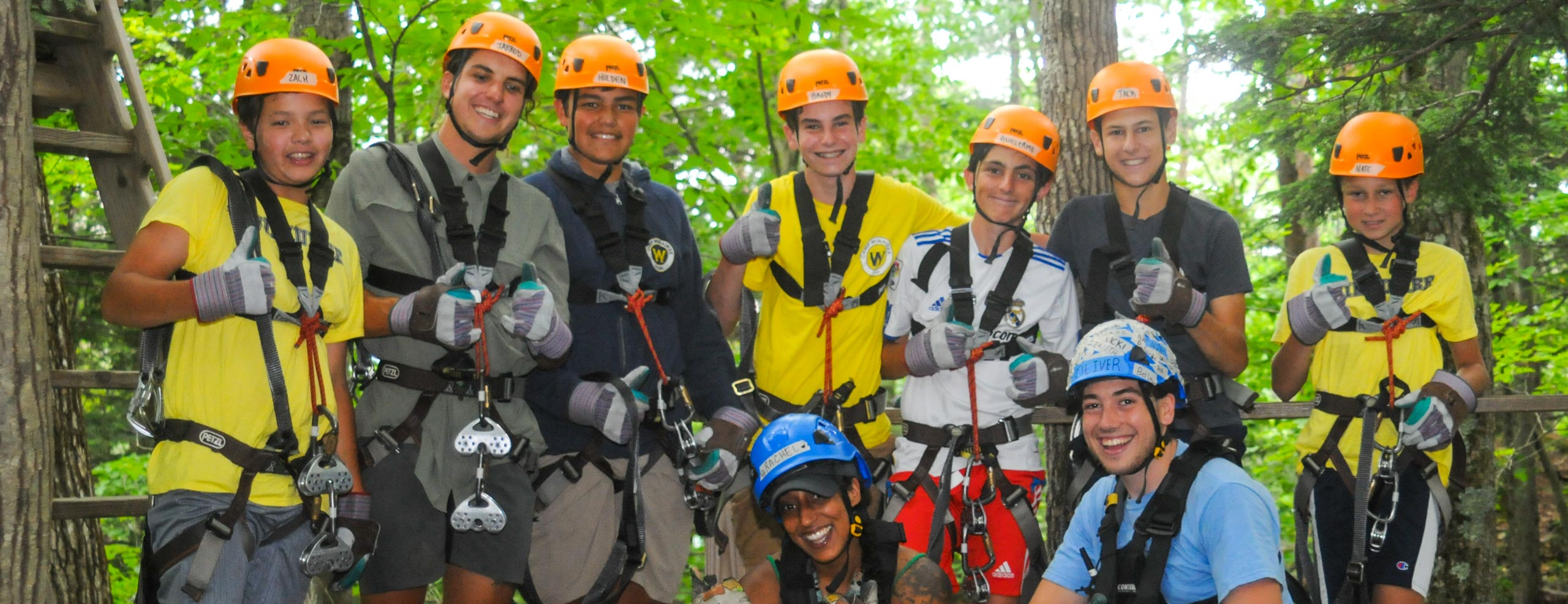 School group kids taking a group photo in zip lining gear