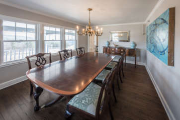 Large wood dining room table and chairs in the bright dining room