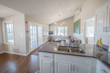 Open concept kitchen looking out toward the living room