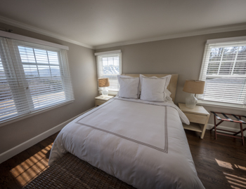 Bright light bedroom with queen bed